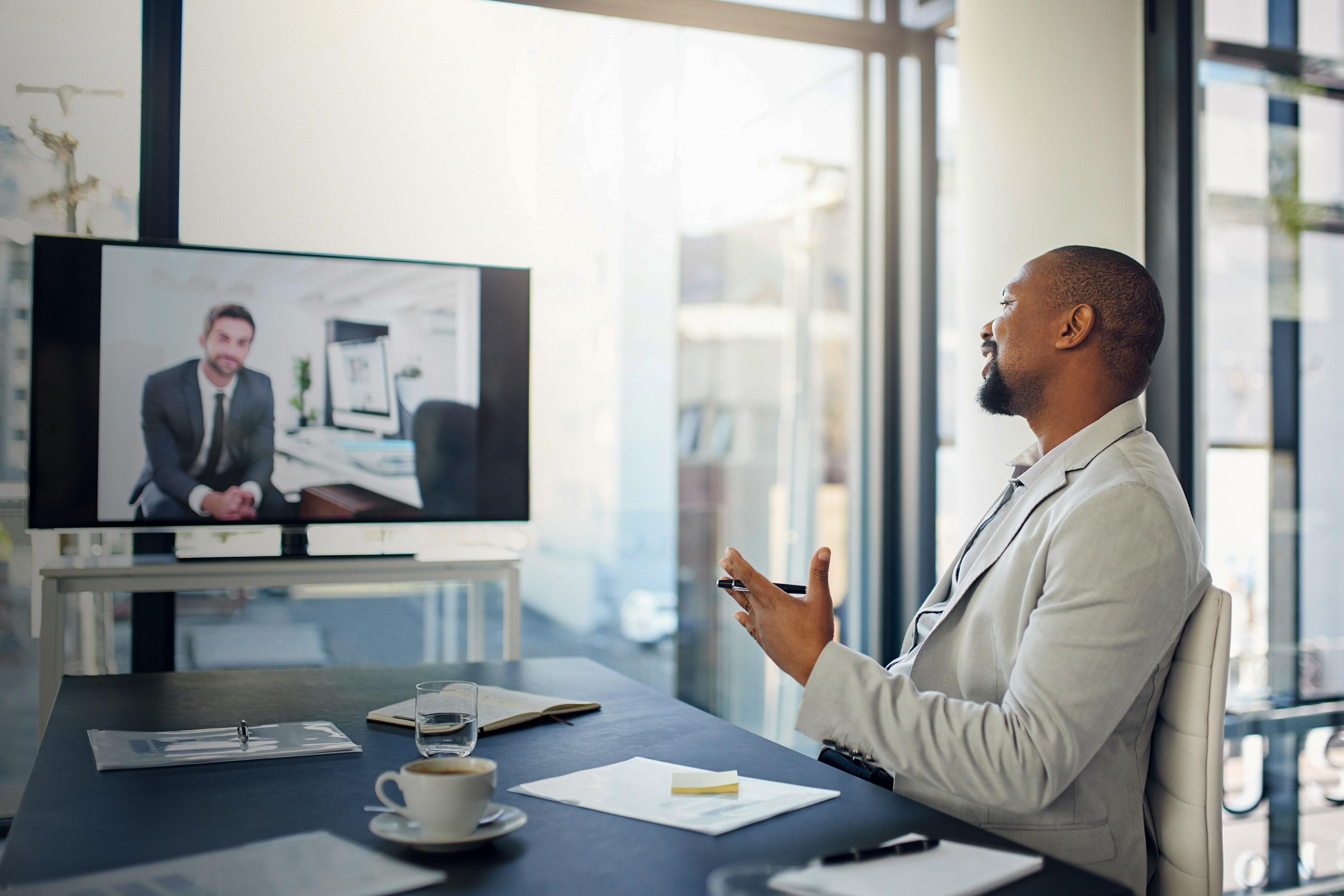 two businessmen having a video conference