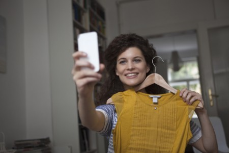 ey-woman-home-taking-selfie-new-clothing