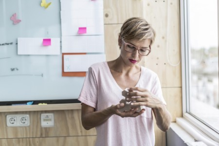 Woman building wooden blocks at office