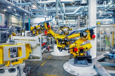 Yellow robots in a car plant