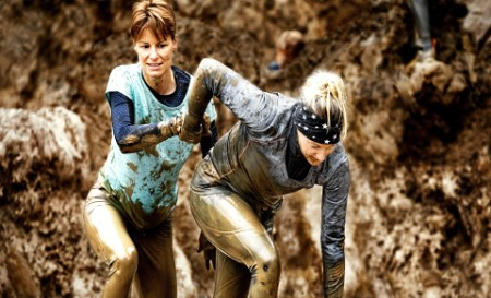 Women participating in muddy run