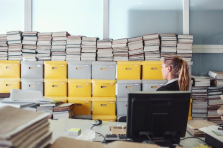 Businesswoman office files paper archives