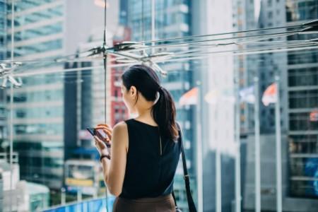 businesswoman text urban skyscrapers background