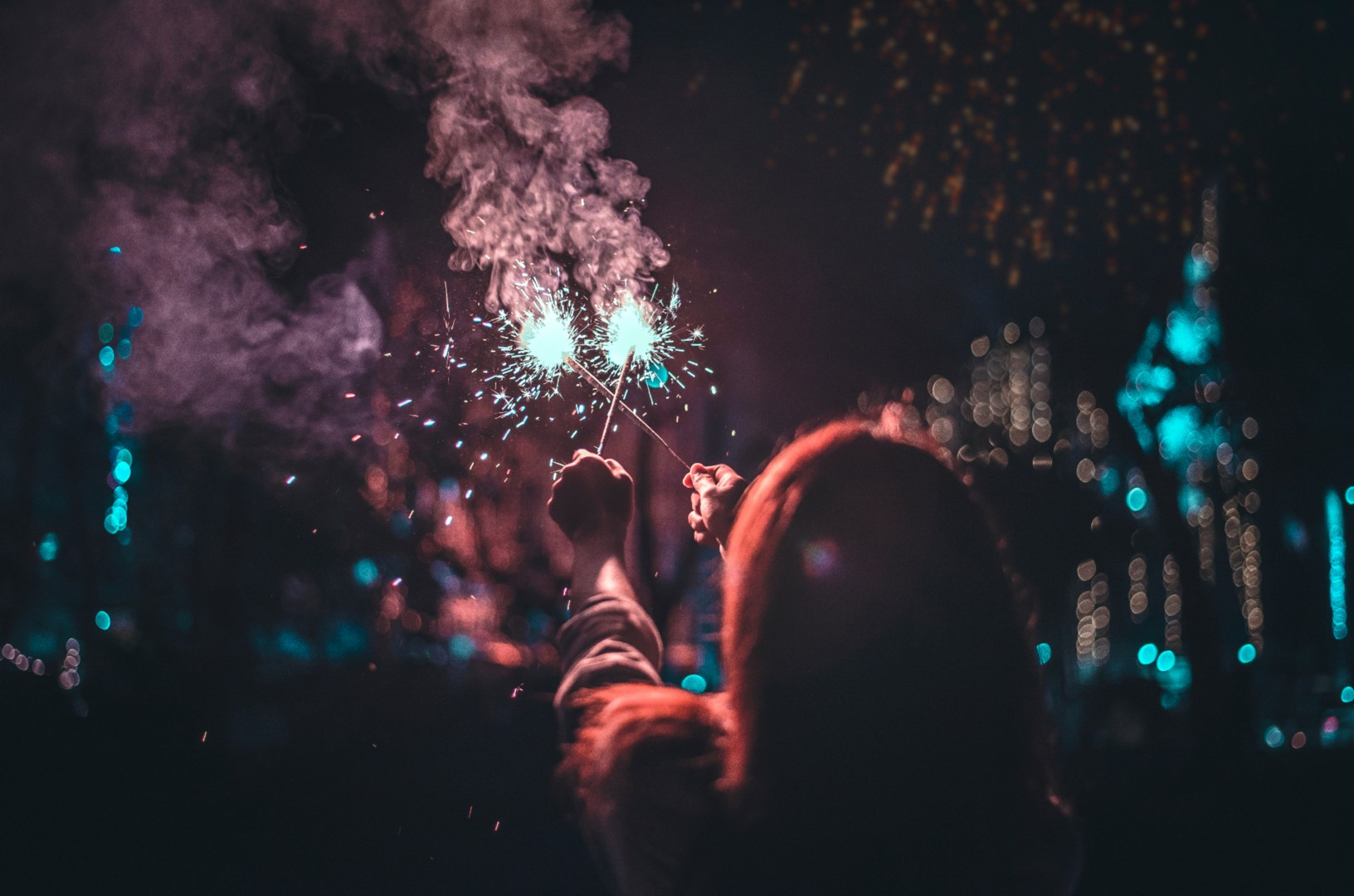 A girl holding firecracker