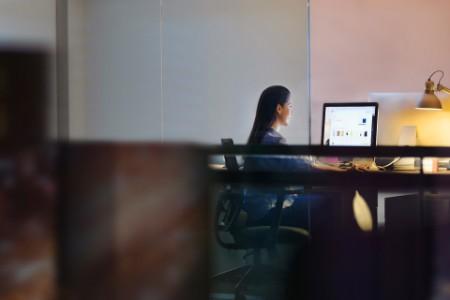 Woman working on computer in design studio