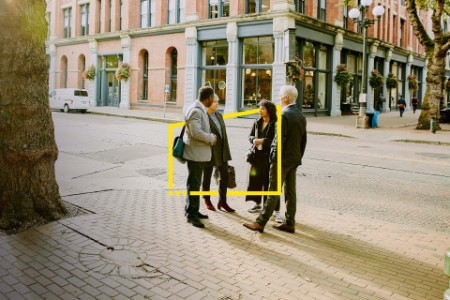 Business colleagues in discussion on city street during morning commute static
