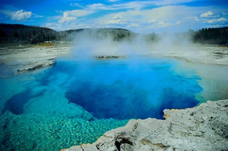 Blue geyser pool with steam