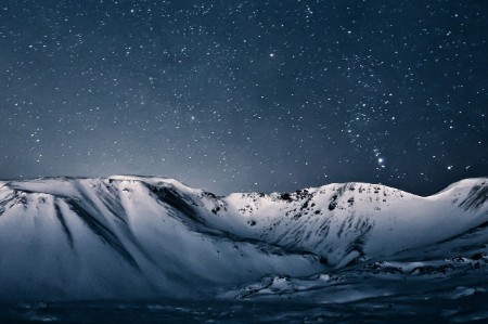 Nighttime view of mountain range in Iceland