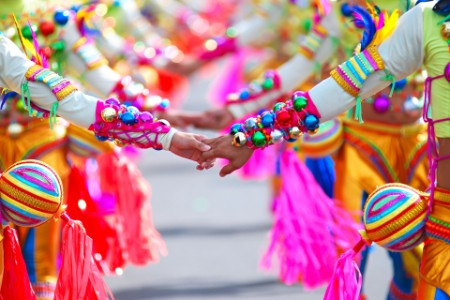 People hold hands at Masskara Festival Philippines