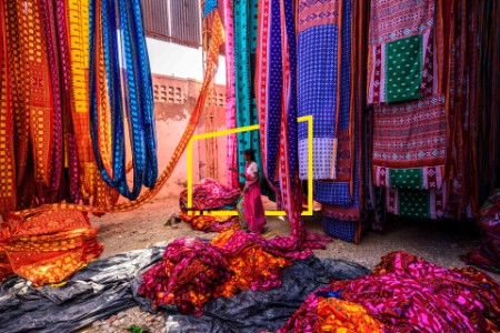 Woman at textile market in India