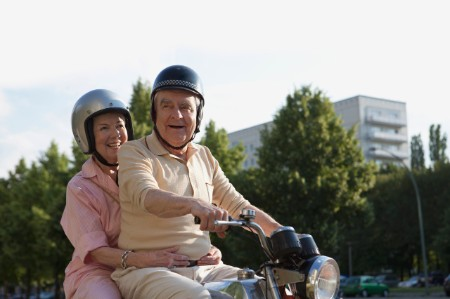 senior couple motorbike