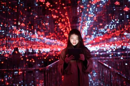 asian woman using digital tablet