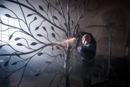 man welding an iron frame