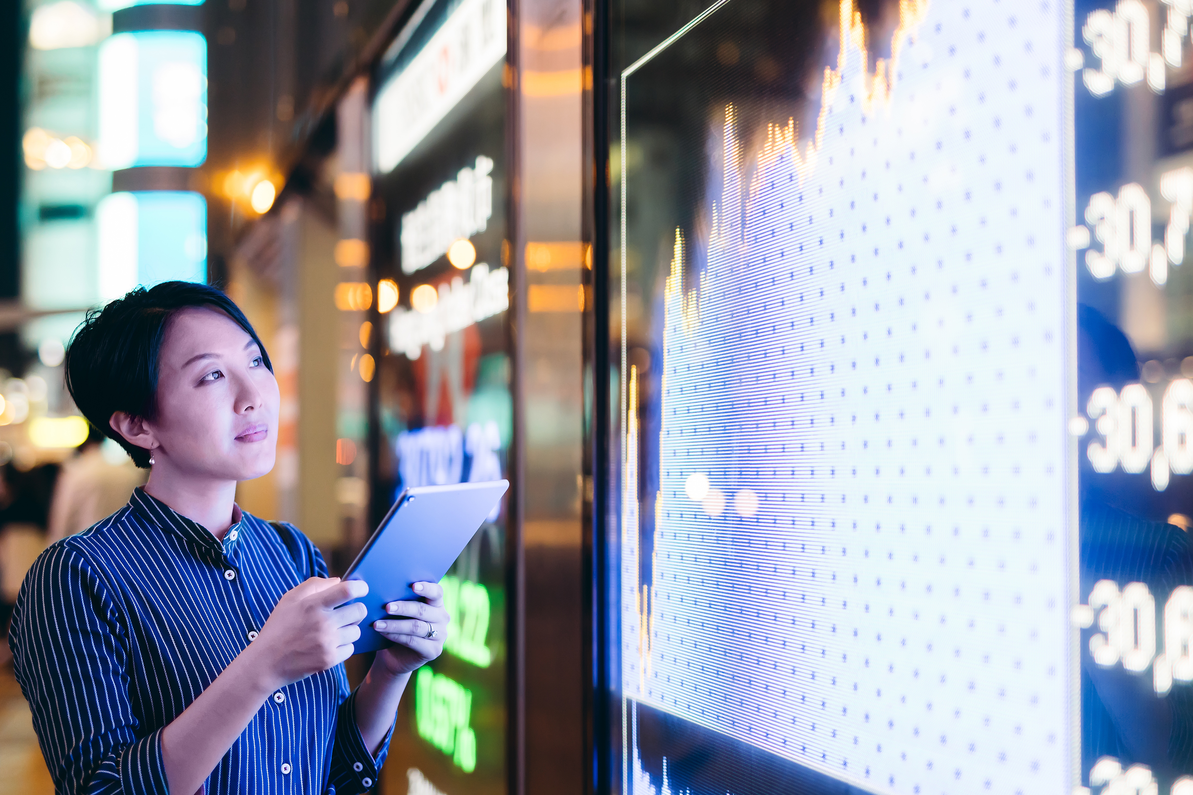 businesswomen checking stock market data
