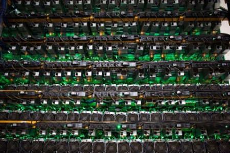 Cryptocurrency mining rigs sit on racks