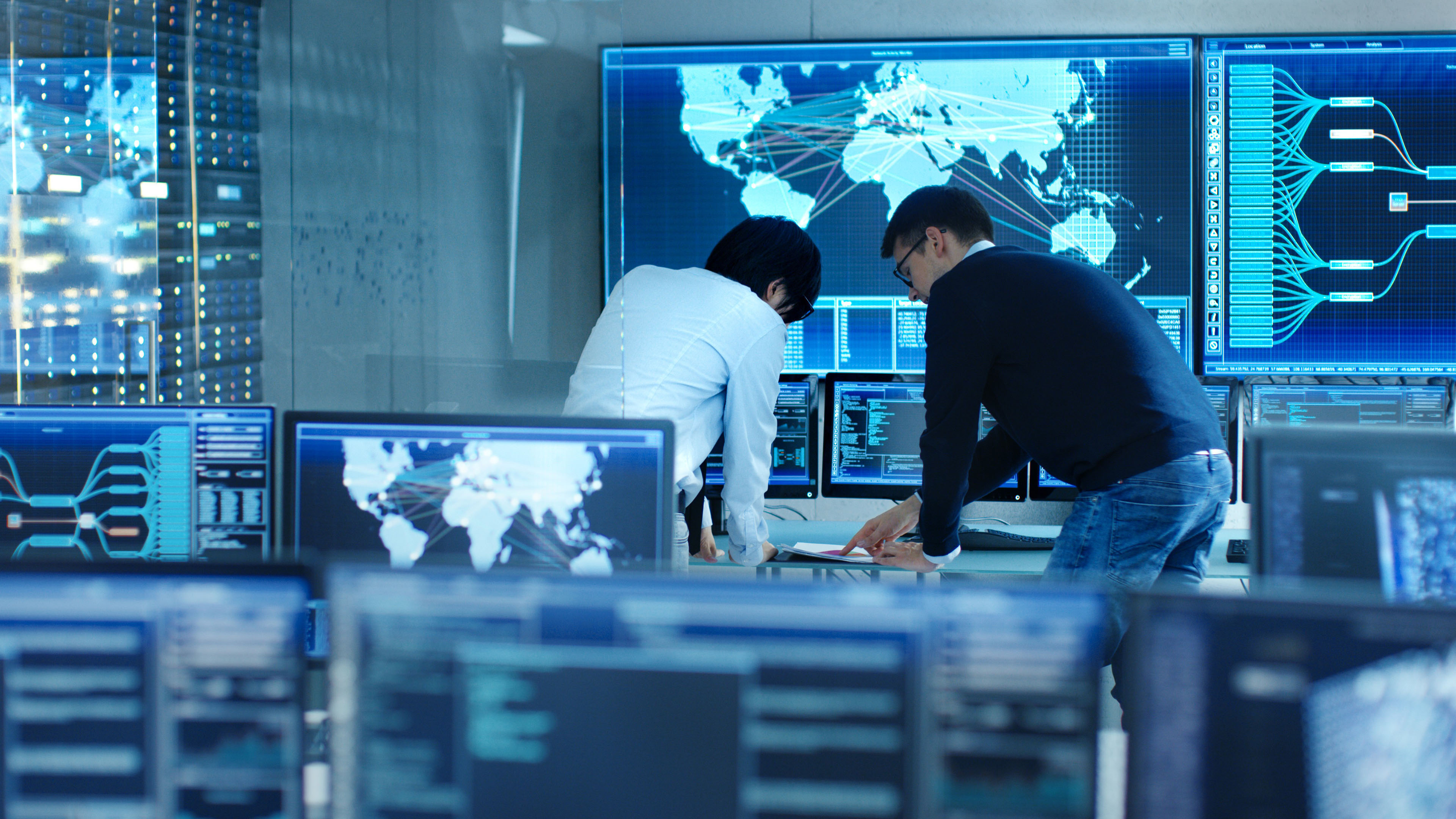 Colleagues working together in server control  image