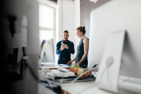 Startup business manager talking to business partner