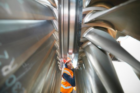 worker inspects turbine power station