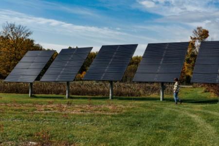 Women standing near solar panels