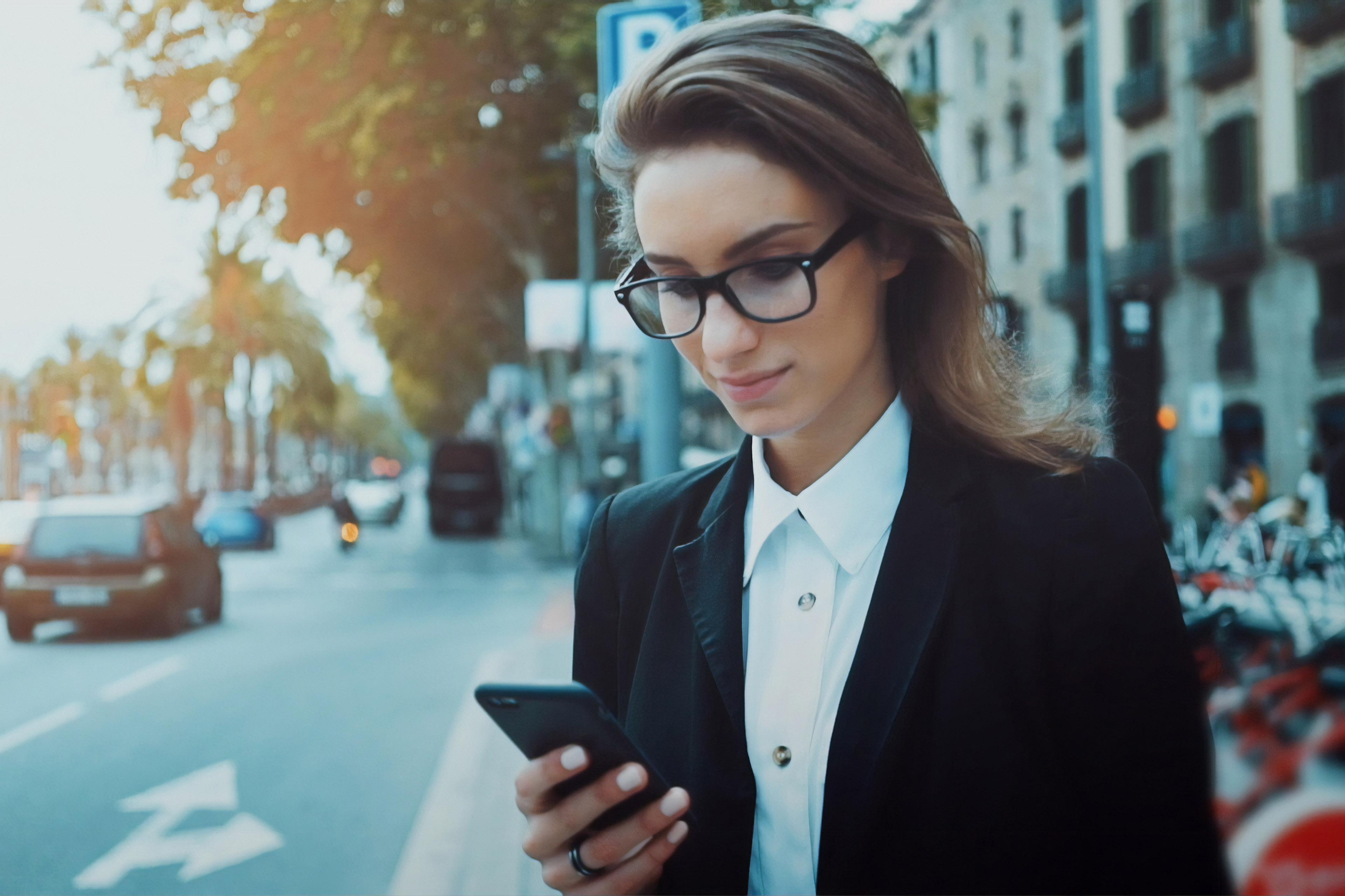 Female auditor using ey digital audit technology on mobile