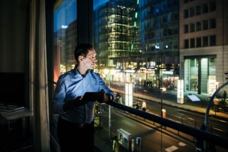 A business man enjoying the night view