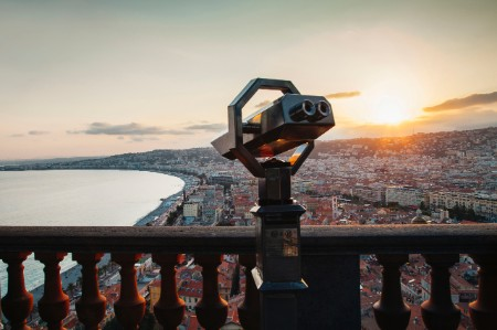 Coin operated binoculars cityscape sky sunset