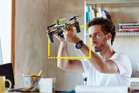 creative businessman making octocopter office