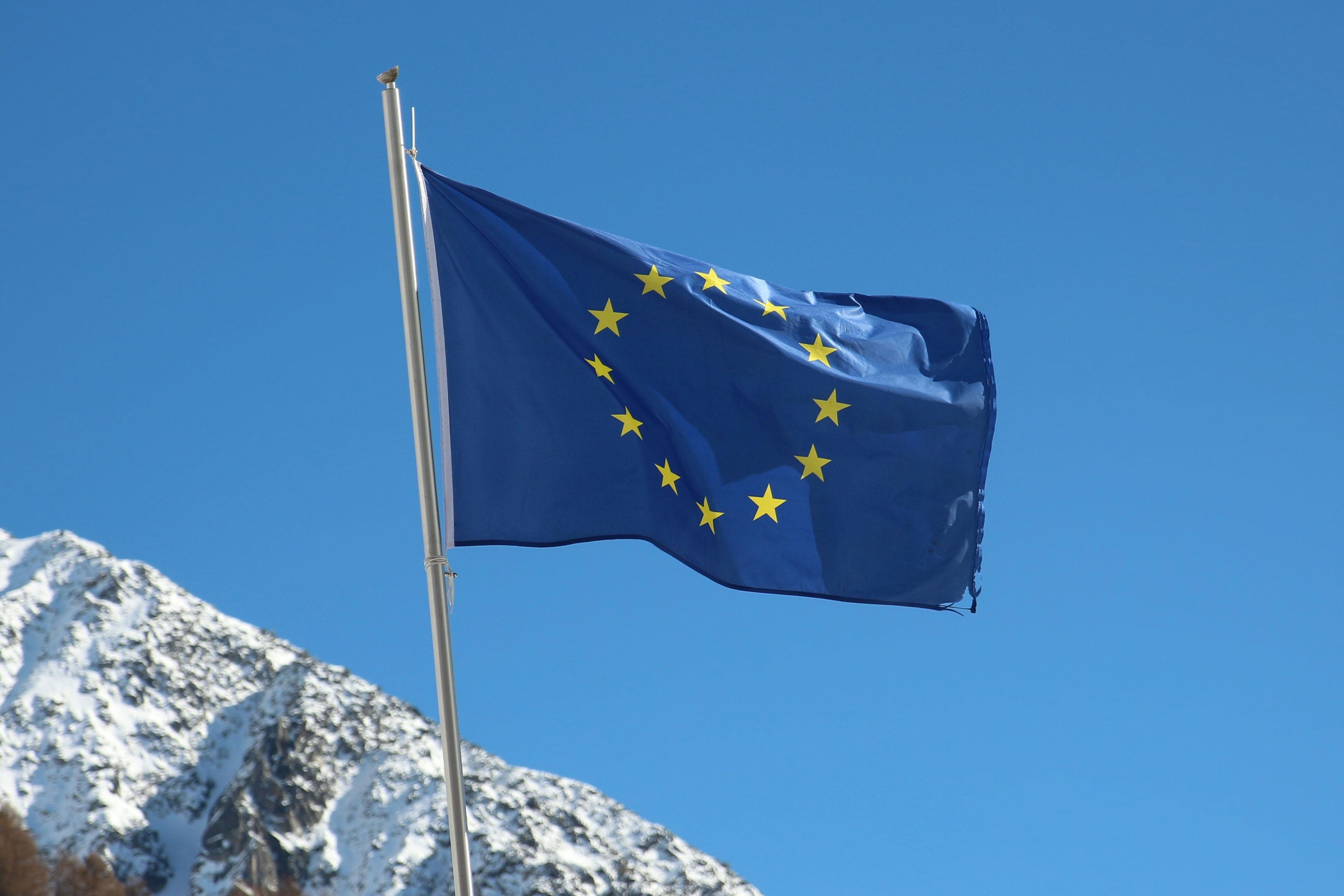 EU flag against mountains