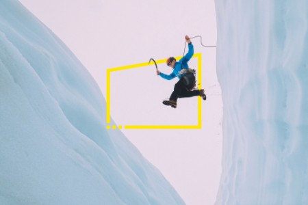 Mountaineer jumps over large crevasse