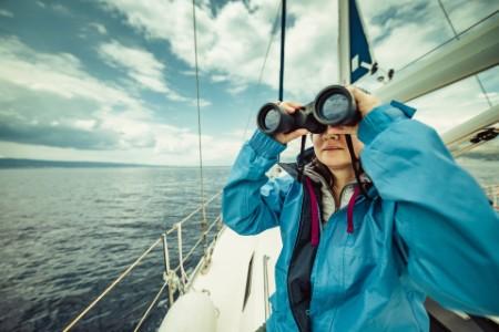 Woman on boat with binoculars