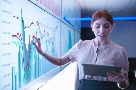 businesswoman graphs screens tablet