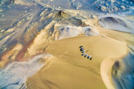 Aerial off road vehicles camping gobi desert