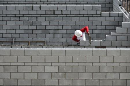 bricklayer working on brick wall palm beach use