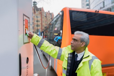 bus driver charging electric bus