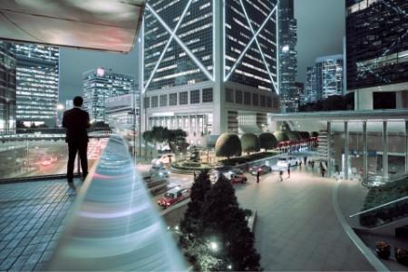 Businessman looking at illuminated central district of hong kong