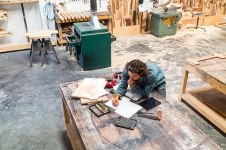Designer working in a furniture factory