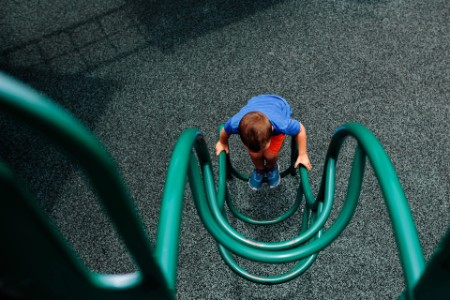 high angle view of child on climbing frame ladder