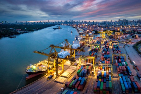 International port crane loading containers bangkok thailand night