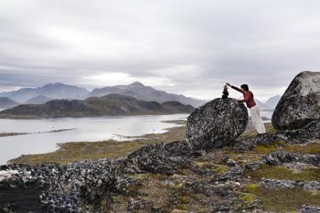 Man building rock cairns