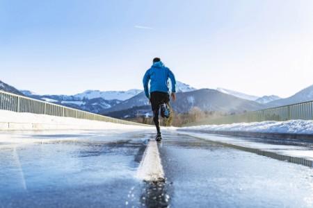Man running on road winter germany bavaria