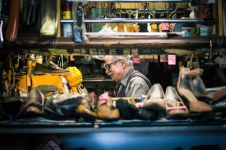 Senior man repairing his shoe