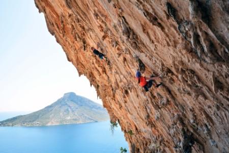 Two climbers on rock wall Kalymnos Greece