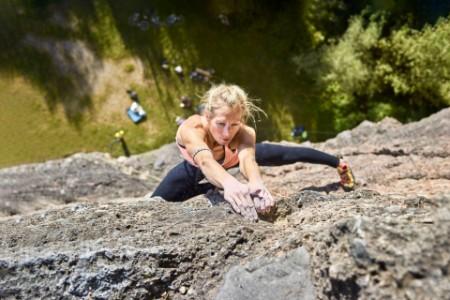 A woman climbing in Hoettingen quarry Austria