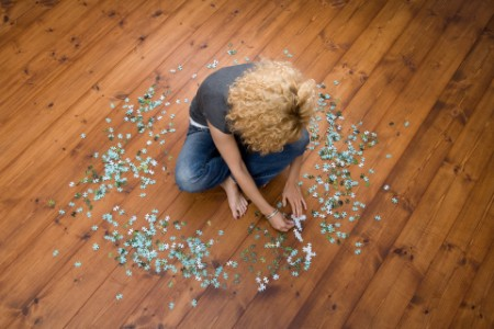 woman doing jigsaw puzzle