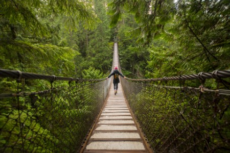 Woman on lynn canyon suspension bridge north vancouver canada