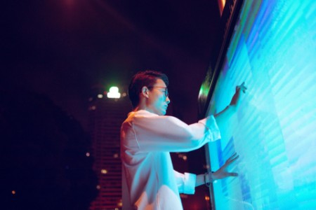Young businessman using touch screen on the street