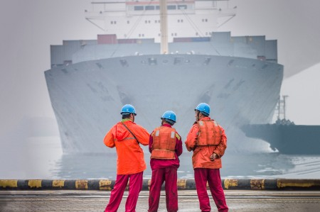 Three workers waiting ship arrive