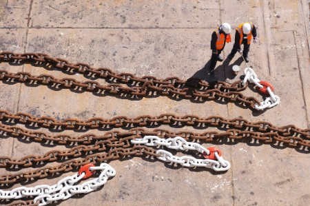 workers anchor chain dry dock