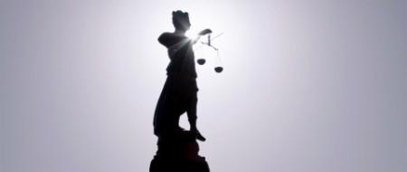 Justice statue sun