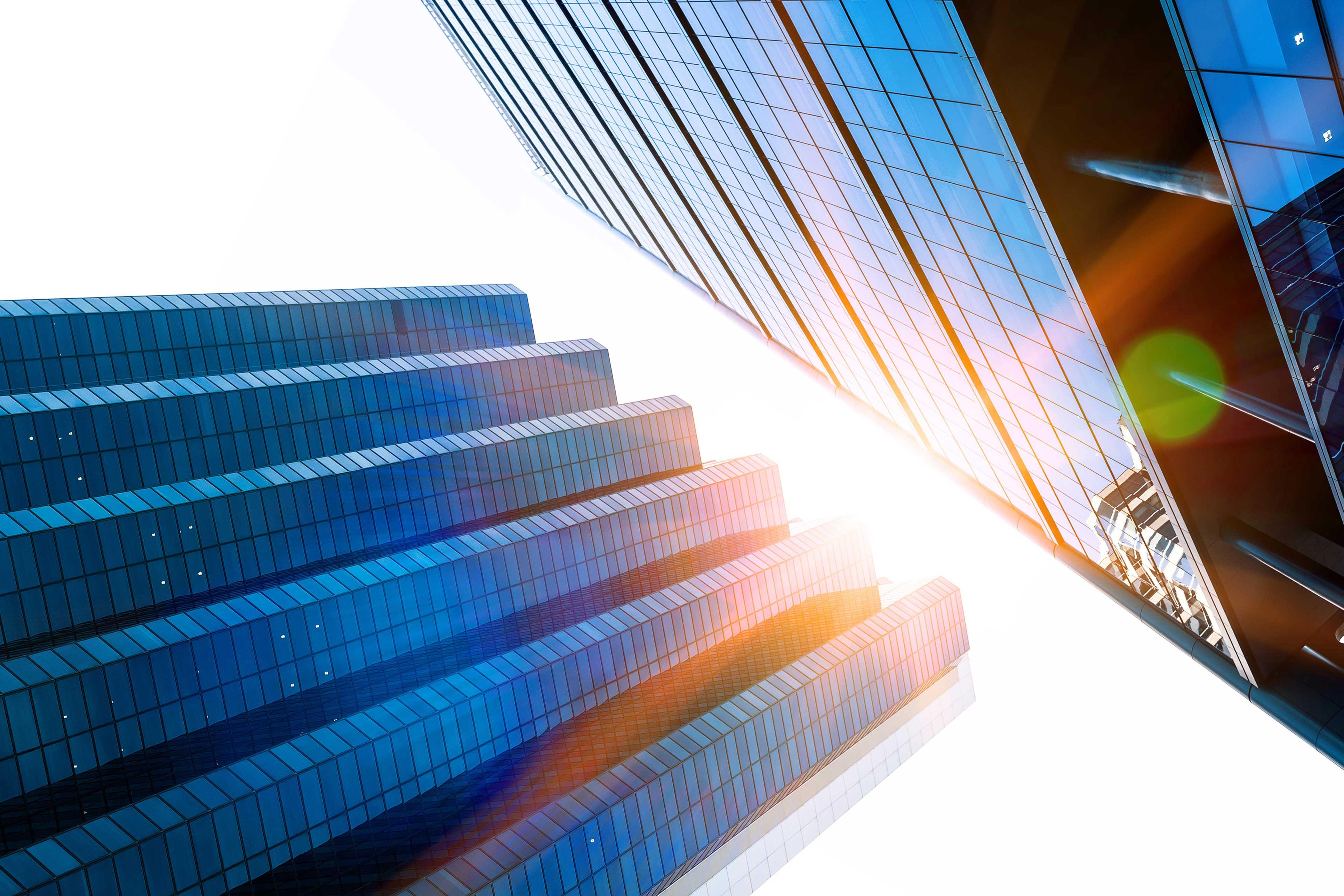Sun gleaming through buildings